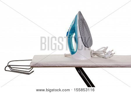 Steam iron and ironing board isolated on white background.