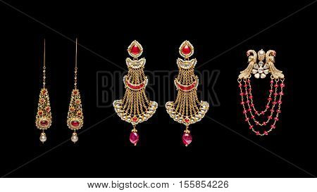 Pairs of designers Earrings with diamonds isolated over black background