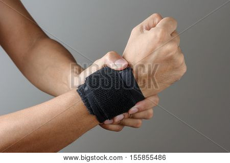 closeup hand with wrist support, medical and sport equipment