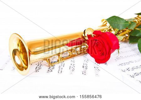 Musical notes and saxophone with red rose