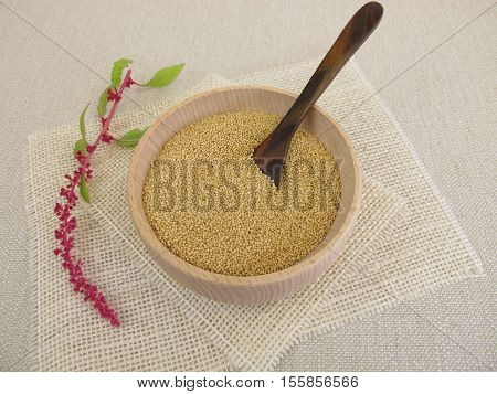 Amarant seeds and plant in wooden bowl