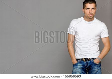 handsome man in a white T-shirt and jeans