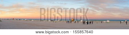 MIAMI BEACH, UNITED STATES - FEBRUARY 12:  People walk and relax at the evening South Beach of Miami near Atlantic Ocean on 12th of February, 2016 in Miami Beach.