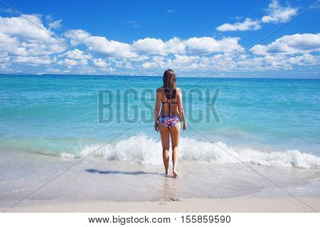 Girl walk at the sunny South Beach of Miami United States