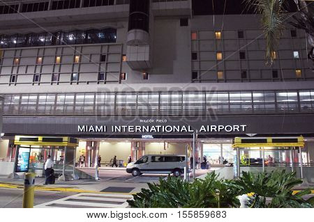 MIAMI, UNITED STATES - FEBRUARY 13: People and cars move alongside the Terminal of Miami International Airport on 13th of February, 2016 in Miami.