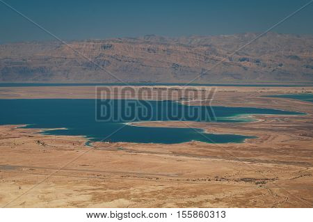 Top view from Masada fortress to the Judean desert and the Dead Sea