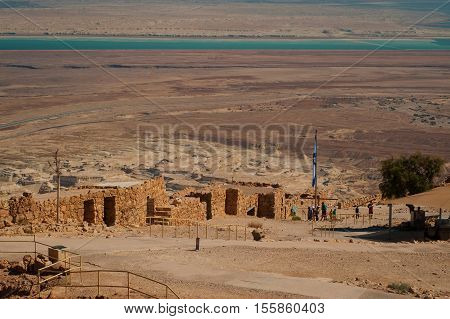 Ruins of fortress Masada. Historical museum. Israel. Judean Desert and Dead sea is on background.