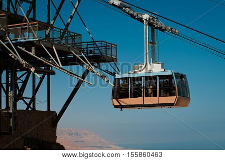 Funicular railway in fortress Masada, Israel. Blue sky and the Dead Sea on background.