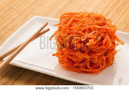 Asian (korean) carrot salad with spices and garlic.