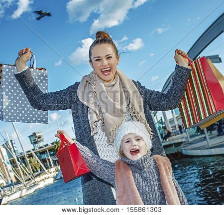 Mother And Child With Shopping Bags In Barcelona Rejoicing