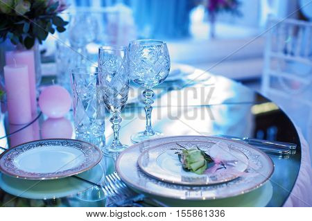 festive decorated table in the restaurant for Christmas in blue and white tone.