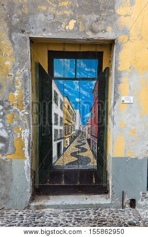 FUNCHAL, MADEIRA, PORTUGAL - SEPTEMBER 4, 2016: The art of open door in the street of Santa Maria. A project which aims to
