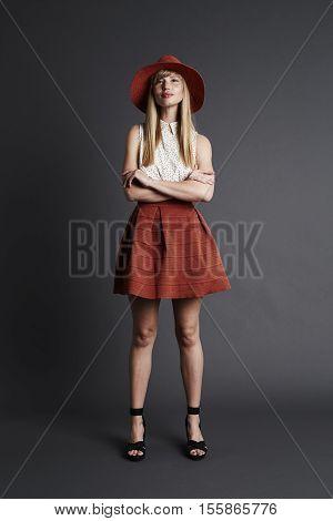 Confident blond female model portrait studio shot