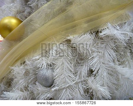 Christmes Decoration With White Tree Branch And Yellow Ball