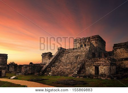 Castillo fortress at sunset in the ancient Mayan city of Tulum Mexico