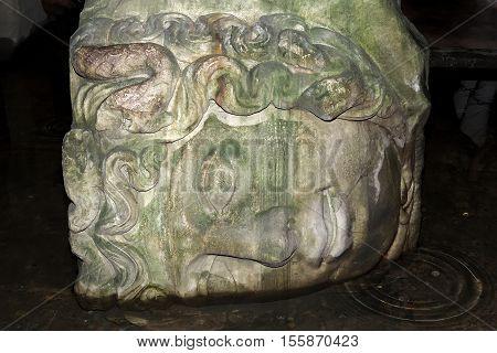 Medusa head sculpture used as a column base in the Basilica Cistern Yerebatan Sarnici , Istanbul