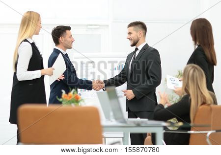 Diversity business team concluding contract with handshake in a