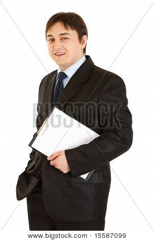 Smiling modern businessman holding blank clipboard in hands isolated on white