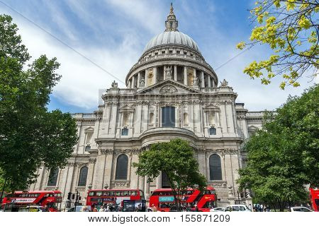 LONDON, ENGLAND - JUNE 15 2016:St. Paul Cathedral and red buses in London, Great Britain