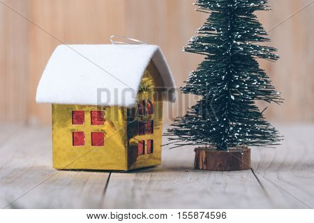 christmas tree and toy house on wood,studio shot.