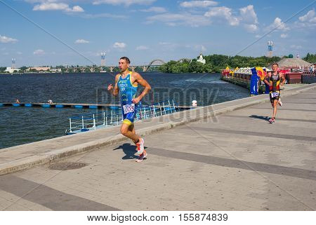 DNEPROPETROVSK, UKRAINE - JULY 06,2013: Sergiy Kurochkin (005) and Dmitro Malyar competing at the men's race during Ukrainian opened triathlon championship  in Dnepropetrovsk Ukraine at July 06, 2013.