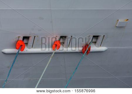 Three Ropes into Ships Hull from Pier