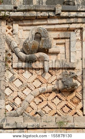 Wall symbol of the two snake in Uxmal Mexico
