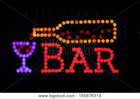 Bar sign advertising wine, drinks and entertainment.