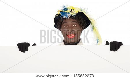 zwarte piet ( black pete)  clipping path included. typical Dutch character part of a traditional event celebrating the birthday of Sinterklaas in december