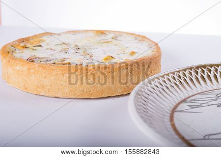 vegetable pie on a plate white background studio photo