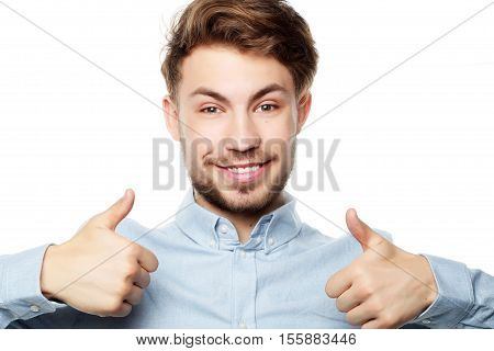 Happy smiling man showing thumb up hand sign isolated on white background