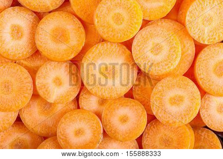 background of carrot slices. fresh carrot background.