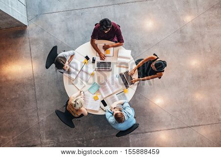 Young People Studying Together Around A Table