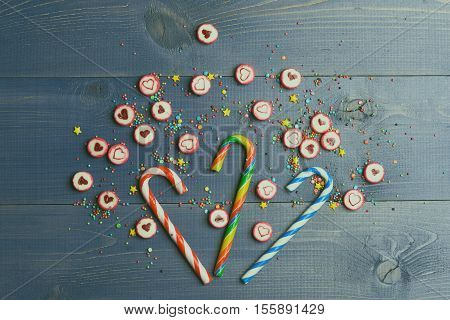 Candies And Colorful Sprinkles On Vintage Background