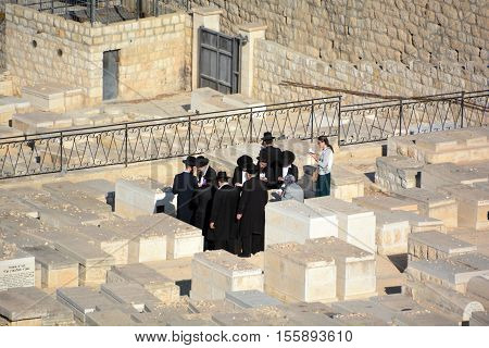 JERUSALEM ISRAEL 23 10 16: Funeral ceremony near graves of the ancestors in the jewish cemetery on Mount of Olives in Jerusalem, Israel