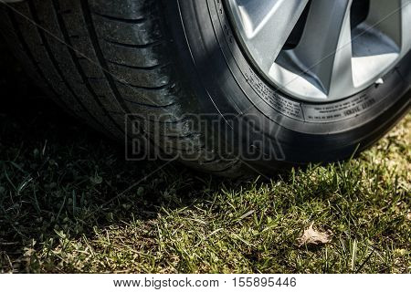 car wheel closeup on the background of green grass