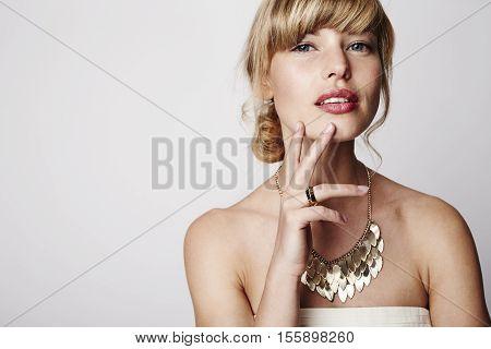 Blue eyed blond bride in studio portrait