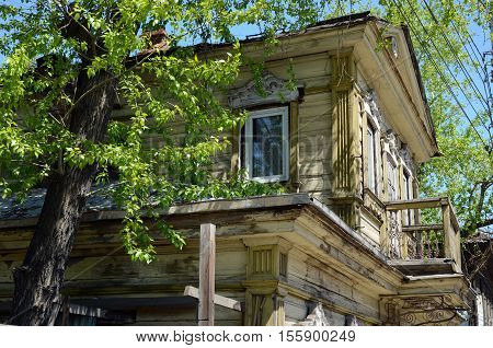 Old Two-storey Wooden House With A Mezzanine In The Center Of Irkutsk
