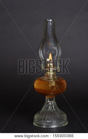 Oil lamp, lit. Use for emergency purposes in lieu of flashlight