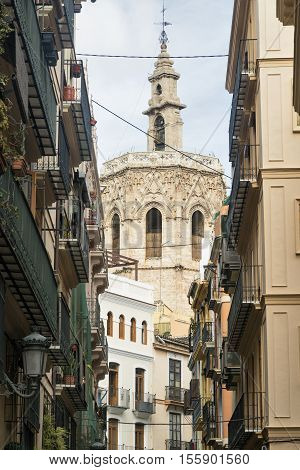 Valencia (Spain) old street with historic houses and a belfry