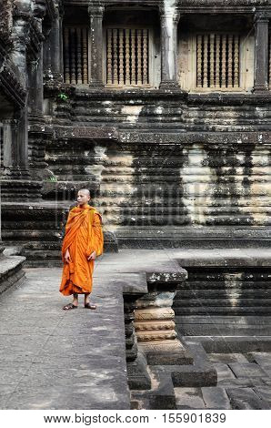 Monk Enters An Ancient Temple At Angkor Wat
