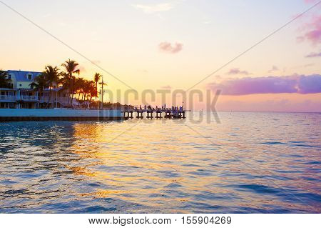 Beautiful sunrise on Key West, Florida, USA. With palms and resorts on background