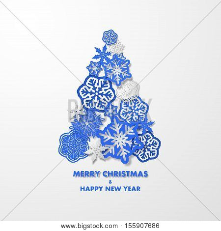 New year background with Christmas tree made of blue 3d snowflakes.