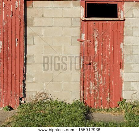 Old red wooden barn door makes a farming background
