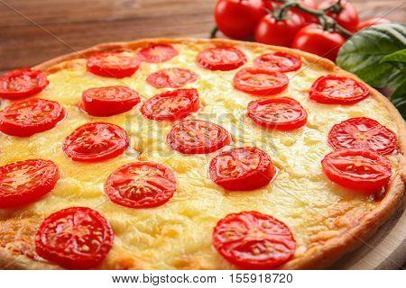 Fresh tasty pizza Margarita, closeup