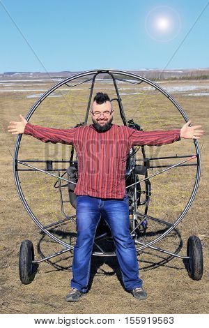 Portrait Of A Man Against The Backdrop Of A Motor Glider