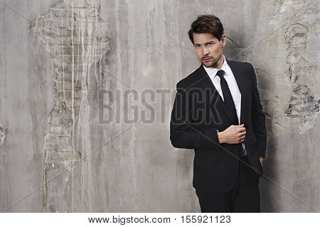 Seriously smart dressed man portrait studio shot