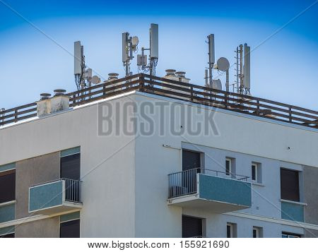 Various internet and cell phone antennas on roof top