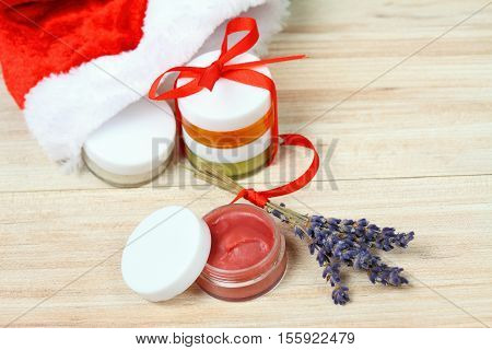 Small Christmas gifts with homemade herbal medicine and copy space around