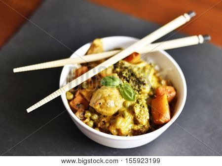 Delicious asian food or indian curry with chopsticks and selective focus. Close-up shot with high angle view.
